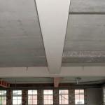 Het aanbrengen van plaatwerk rondom H-profielen, constructiewerken of leidingen.